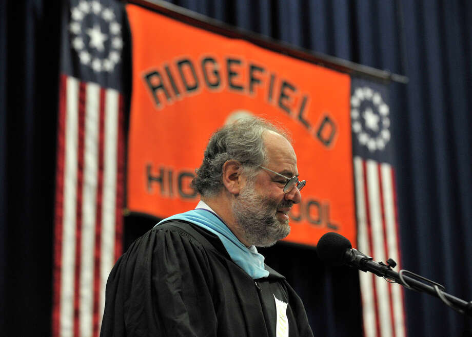 Retiring Principal Jeffrey Jaslow addresses the Class of 2012 during the Ridgefield High School graduation at the O'Neill Center at Western Connecticut State University's westside campus on Friday, June 22, 2012. Photo: Jason Rearick / The News-Times