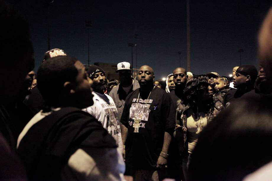 "Friends and family including rapper, Trae, center, listen to testimonies, during a candlelight vigil for Dominic Levar Brown, better known as, Money Clip D, Wednesday, November 30, 2011 at Amity Park in Houston, Texas. Brown, 34, described as ""right-hand man"" to local Houston rapper Trae, was sitting in a car and talking to friends outside the Breakers after-hours club in the 9600 block of Bissonnet when an unknown gunman opened fire about 5:30am fatally wounding him. (Todd Spoth / For The Chronicle) Photo: TODD SPOTH / Todd Spoth"