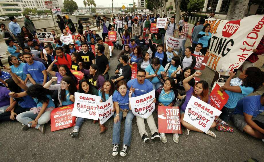 More than 150 students and Dream Act supporters rallied in front of the Federal Office Building in downtown Los Angeles, California, on Friday, June 15, 2012, to voice their support for President Obama's decision to halt the deportation of young illegal immigrants. (Al Seib/Los Angeles Times/MCT) Photo: Al Seib / Los Angeles Times
