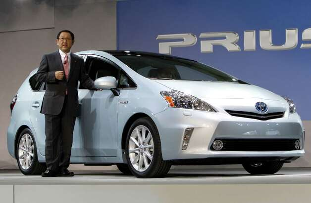 FILE- This Monday, Jan. 10, 2011, file photo, shows Akio Toyoda, President of Toyota Motor Corporation introducing the Prius V midsize hybrid-electric vehicle at the North American International Auto Show in Detroit. The five-seat Prius V gets an estimated 42 miles per gallon in city and highway driving, helping to make it ideal for a family road trip. It's also roomier than a standard Prius, with 13 additional cubic feet of luggage space behind the rear seats. Photo: Paul Sancya, . / AP2011