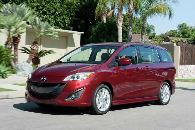 The Mazda5 weighs more than 1,000 pounds less than the Odyssey. Less weight means less horsepower is needed to move it around. It also means less weight while driving, making the Mazda5 one of the only minivans that's actually fun to drive. Photo: HANDOUT, . / MCT