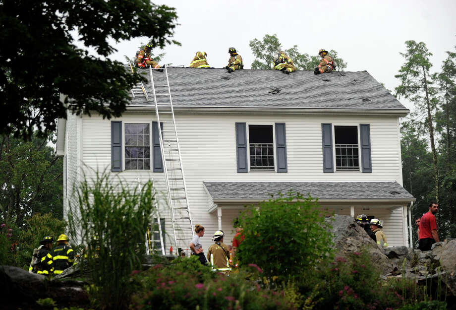 A house on Carmen Hill Road No. 1 in New Milford was heavily damaged by fire, Friday evening, June 22, 2012. Photo: Carol Kaliff / The News-Times