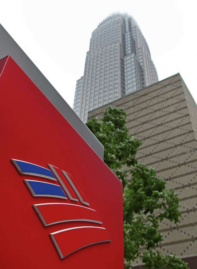 FILE -- An April 19, 2012 file photo shows Bank of America's corporate headquarters  in Charlotte, N.C.  Moody's Investors Service Thursday June 21, 2012 has lowered the credit ratings on some of the world's biggest banks, including Bank of America.  (AP Photo/Chuck Burton) Photo: Chuck Burton / AP2012