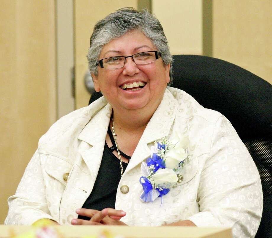 South San Antonio Independent School District's new superintendent Rebecca Robinson listens to speakers during a board meeting held Friday June 22, 2012 at district headquarters. Photo: Edward A. Ornelas, San Antonio Express-News / ¨ 2012 San Antonio Express-News