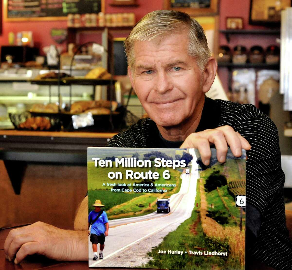 Joe Hurley, of New Milford, holds a copy of his new book,