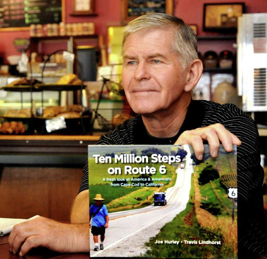"""Joe Hurley, of New Milford, holds a copy of his new book, """"Ten Million Steps,"""" Thursday, June 14, 2012. Photo: Michael Duffy / The News-Times"""