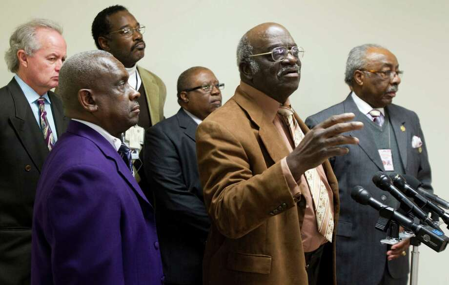 The Rev. Robert Jefferson, in brown jacket, stands with other ministers during a news conference to protest the Chad Holley beating case Tuesday, Feb. 8, 2011, in Houston. The protest was sparked by the released video tape of 15-year-old burglary suspect Chad Holley being beaten by police as he is arrested outside a storage facility. ( Brett Coomer / Houston Chronicle ) Photo: Brett Coomer / © 2011 Houston Chronicle