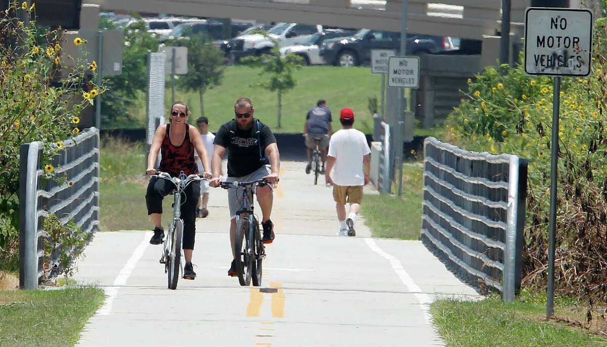 Cyclists ride along a bike trail in the Heights on Friday, when a $15 million federal grant for bike paths in Houston was announced.