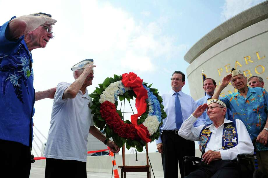 Veterans Floyd Welch, 91, of East Lyme, Jack Stoeber, 96, of Milford, William Lehr, 91, of Hamden, and Thomas Nerkowski, 91, of Branford, from left, salute during the veterans wreath dedication as Gov. Dannel Malloy and Sen. Richard Blumenthal look on during a ribbon cutting ceremony for the new Pearl Harbor Memorial Bridge Friday, June 22, 2012 in New Haven, Conn. Photo: Autumn Driscoll / Connecticut Post