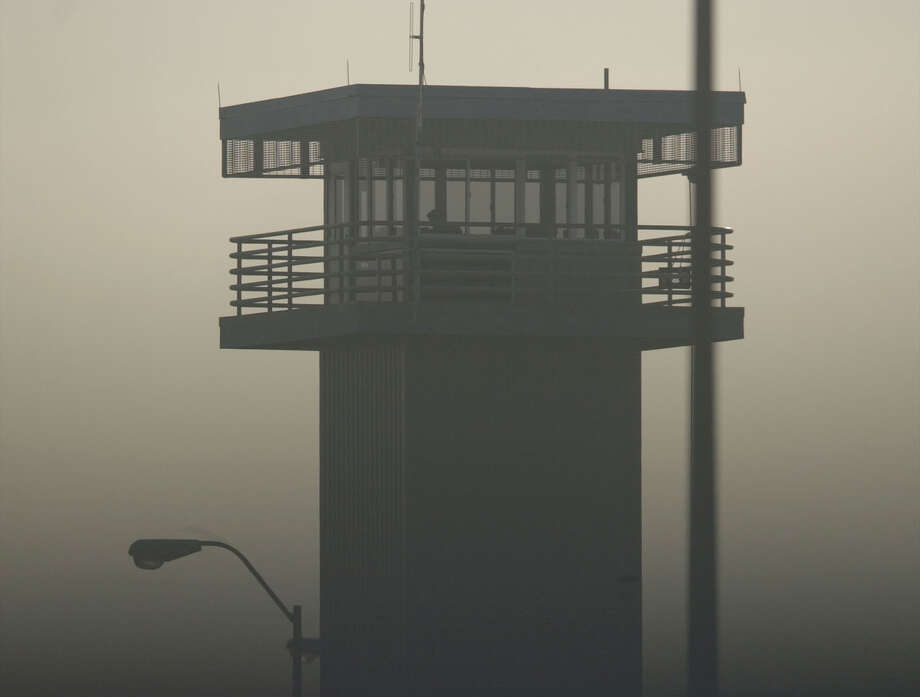 Morning mist surrounds a guard tower on the grounds of the John B. Connally Unit of the Texas Department of Criminal Justice Thursday, Dec. 14, 2000, in Kenedy, Karnes County, where seven prisoners escaped Wednesday. Little trace remained Thursday of the seven inmates, including two convicted murderers, who used cunning and force to break out of a South Texas prison. The escapees stole 14 .357 Magnum pistols with 238 rounds of ammunition, a loaded automatic rifle and a loaded shotgun from the guard tower. (AP Photo/San Antonio Express-News, Bill Calzada) Photo: BILLY CALZADA / SAN ANTONIO EXPRESS-NEWS