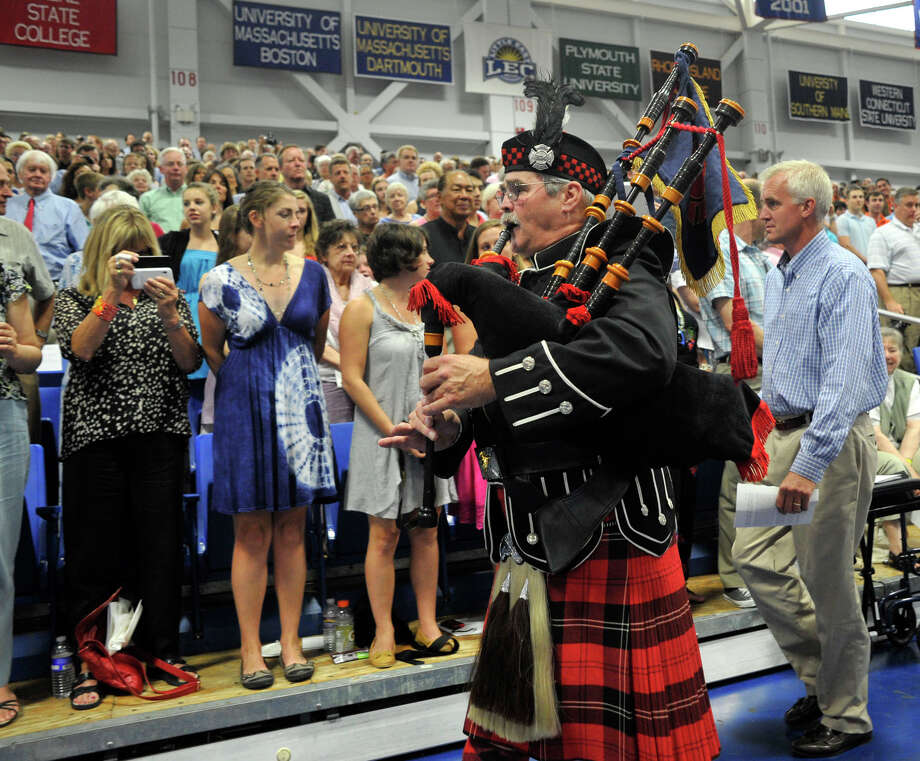 Terrence Shay plays the bag pipes during the bag pipe processional at the Ridgefield High School graduation at the O'Neill Center at Western Connecticut State University's westside campus on Friday, June 22, 2012. Photo: Jason Rearick / The News-Times