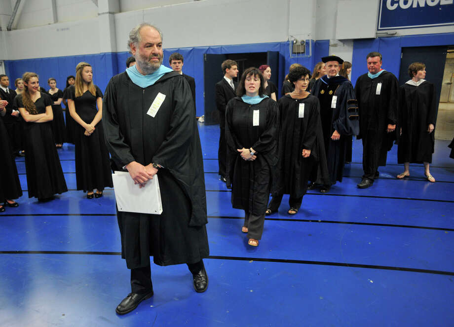 Retiring Principal Jeffrey Jaslow, left, and other school officials wait to process in during the Ridgefield High School graduation at the O'Neill Center at Western Connecticut State University's westside campus on Friday, June 22, 2012. Photo: Jason Rearick / The News-Times