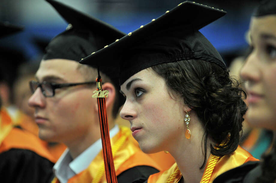 Becca Maher listens to the speakers during the Ridgefield High School graduation at the O'Neill Center at Western Connecticut State University's westside campus on Friday, June 22, 2012. Photo: Jason Rearick / The News-Times
