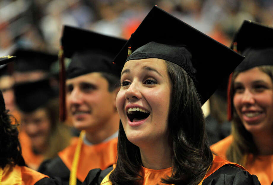 Kelly Aaronson reacts to the remarks of Principal Jeffrey Jaslow during the Ridgefield High School graduation at the O'Neill Center at Western Connecticut State University's westside campus on Friday, June 22, 2012. Photo: Jason Rearick / The News-Times