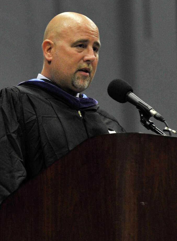 Chairman of the Ridgefield Board of Education Austin Drukker speaks during the Ridgefield High School graduation at the O'Neill Center at Western Connecticut State University's westside campus on Friday, June 22, 2012. Photo: Jason Rearick / The News-Times