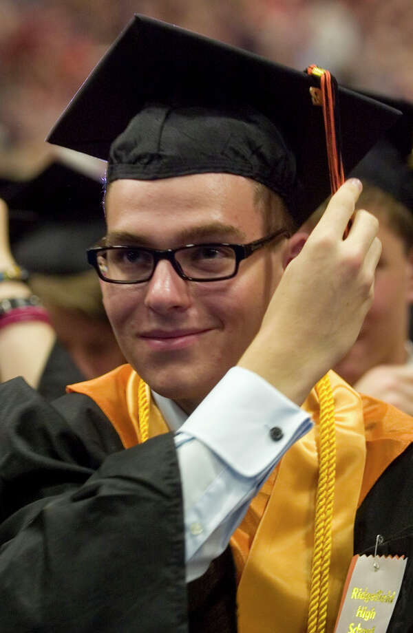 Charlie Yolen turns his tassel during the Ridgefield High School graduation at the O'Neill Center at Western Connecticut State University's westside campus on Friday, June 22, 2012. Photo: Jason Rearick / The News-Times