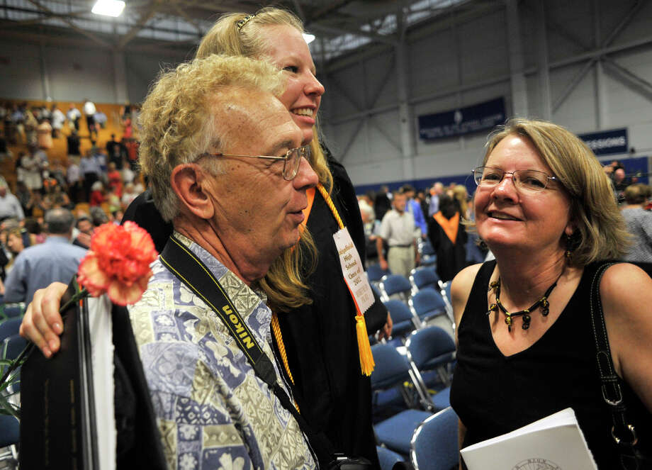 Jenna Jones, center, greets her grandparents, Brian Klepinger and Cyndy Klepinger, following the Ridgefield High School graduation at the O'Neill Center at Western Connecticut State University's westside campus on Friday, June 22, 2012. Photo: Jason Rearick / The News-Times