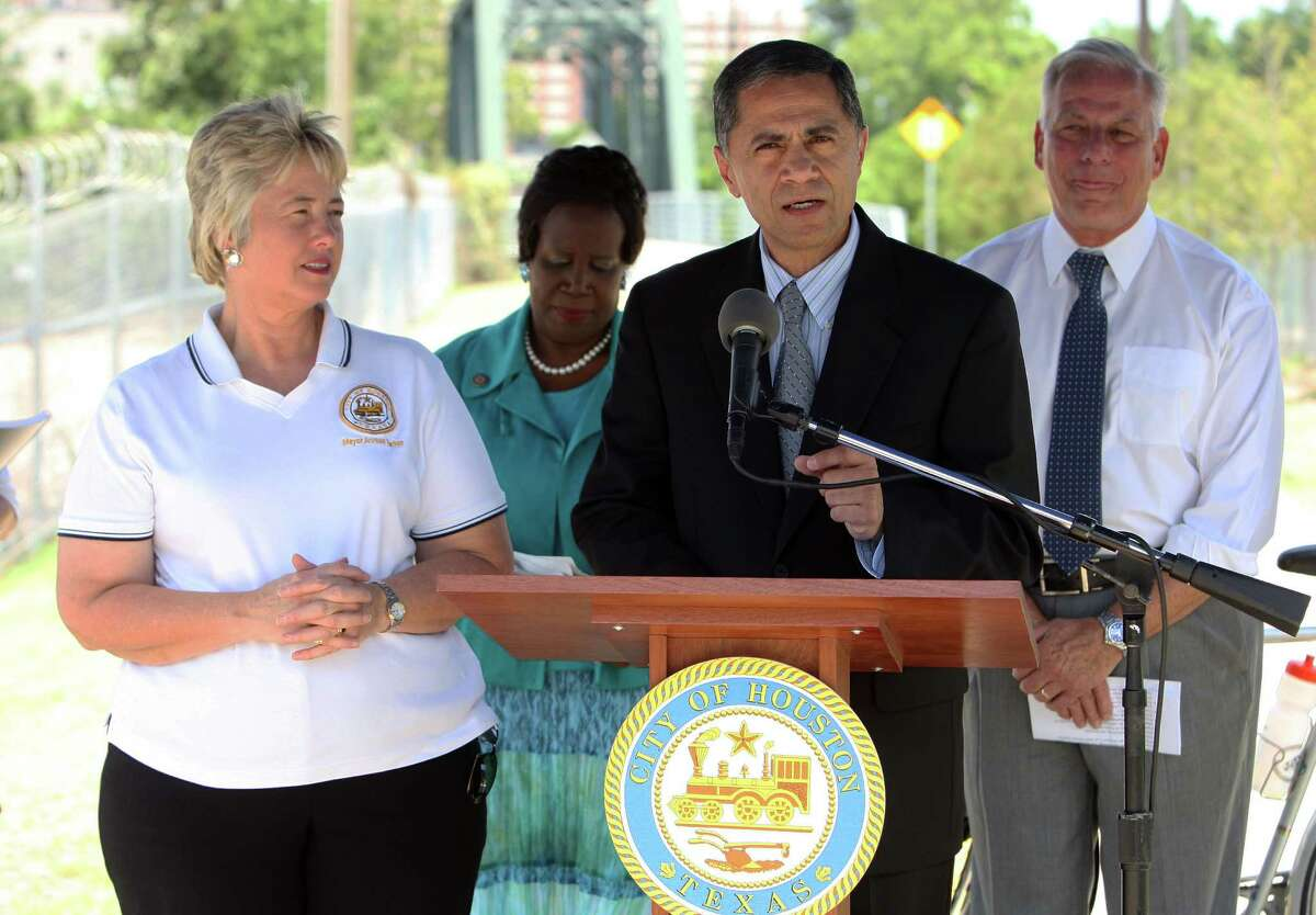 Federal Highway Administrator Victor Mendez during a speech announcing the the U.S. Department of Transportation's $15 million Tiger (Transportation Investment Generating Economic Recovery) grant along with Houston Mayor Annise Parker left, Congresswoman Sheila Jackson Lee 2nd from left and Congressman Gene Green right, the grant will allow the city to build off-street shared-use paths, sidewalks and on-street bikeways Friday, June 22, 2012, in Houston.