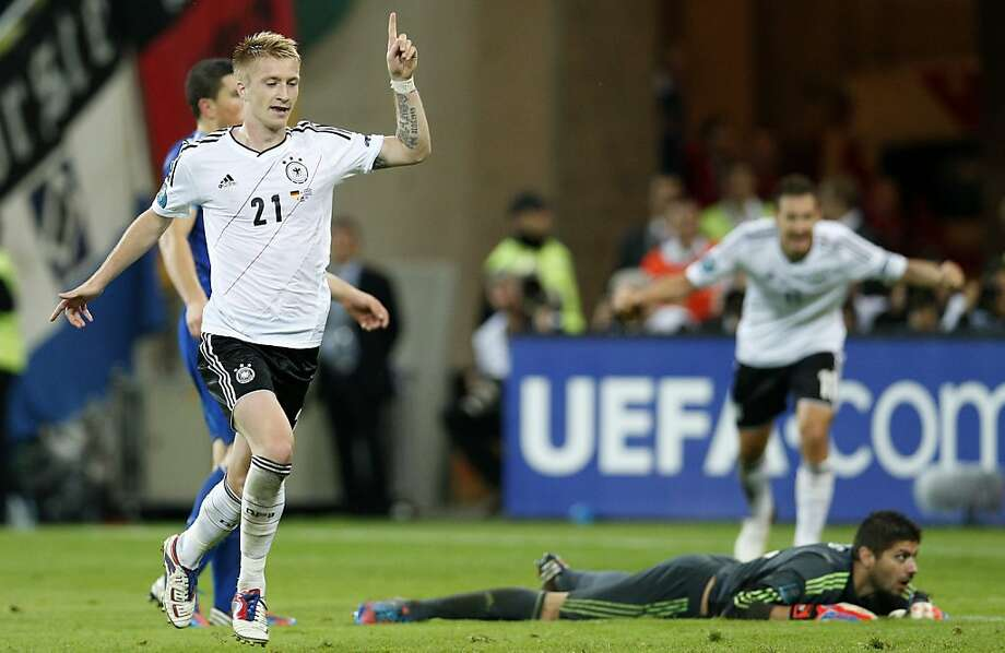 Germany's Marco Reus celebrates scoring his side's fourth goal during the Euro 2012 soccer championship quarterfinal match between Germany and Greece in Gdansk, Poland, Friday, June 22, 2012. (AP Photo/Michael Sohn) Photo: Michael Sohn, Associated Press