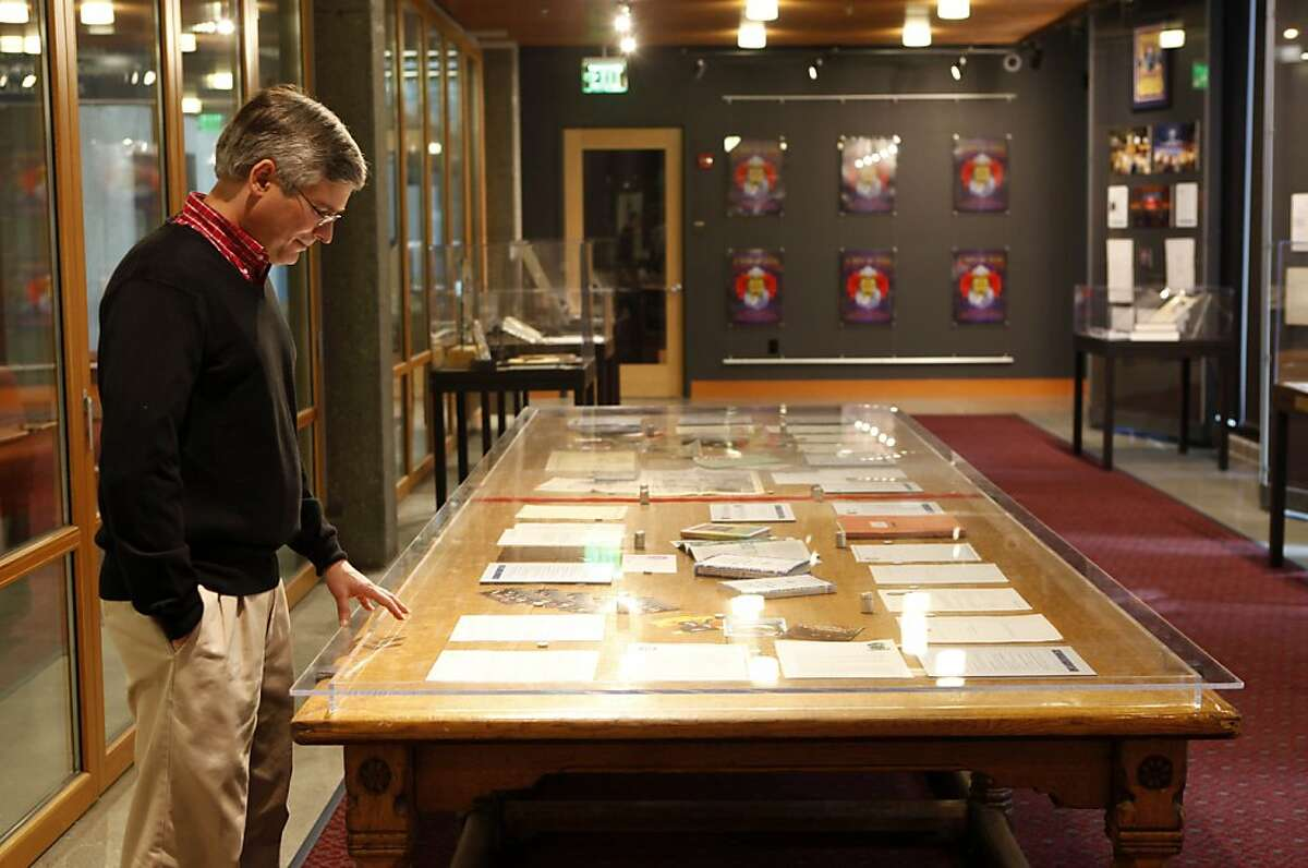 Nicholas Meriwether stands at the Grateful Dead's conference table by some of his favorite pieces in the museum on Wednesday, June, 20, 2012. The Grateful Dead Archive has opened to the public on the University of California Santa Cruz's McHenry Library this week.