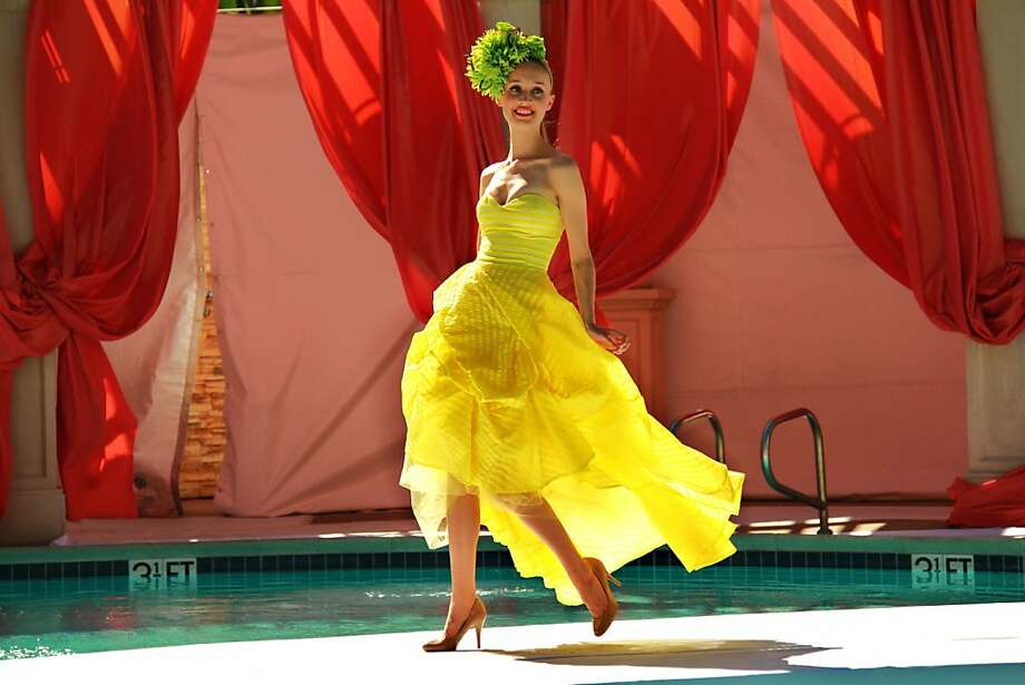 Scenes from Santana Row's Poolside Fashion Shows June 1 in San Jose. The model wears a canary yellow strapless gown by Franco Uomo. Photo: Edric Itchon