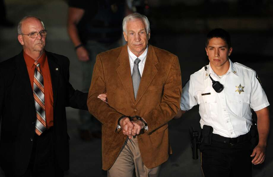 Former Penn State assistant coach Jerry Sandusky leaves the Centre County Courthouse in Bellefonte, Pa.,  in handcuffs on Friday night after being found guilty of sexually assaulting 10 boys. Photo: Nabil K. Mark / Centre Daily Times