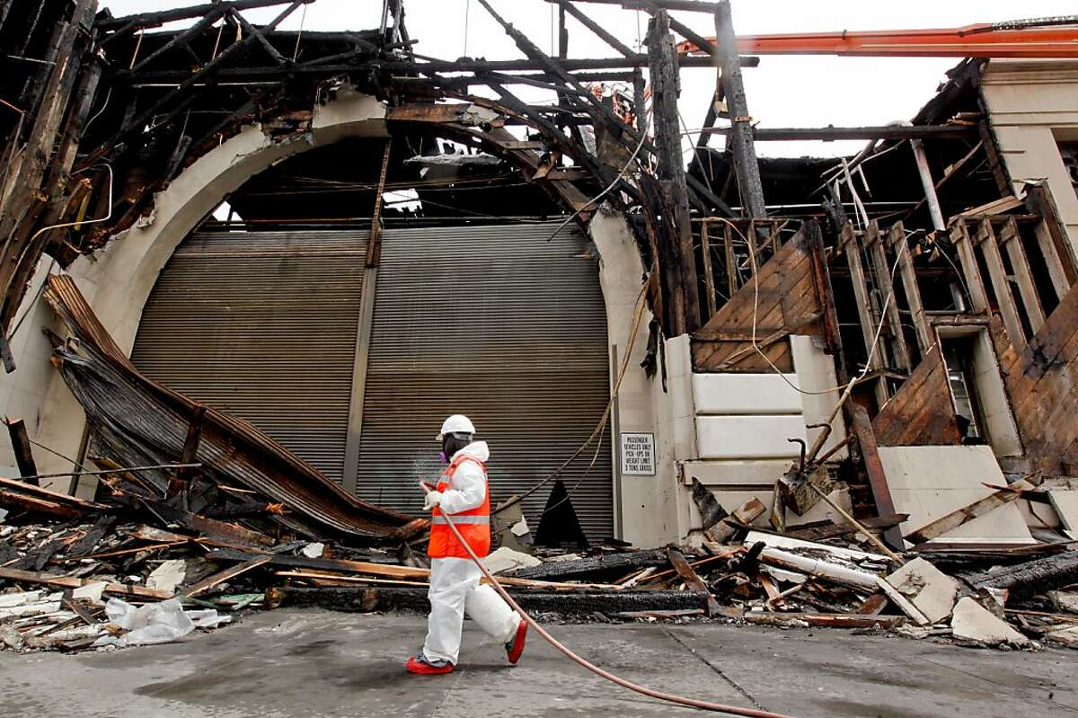 The clean up and investigation of Pier 29 along the Embarcadero, on Friday June 22, 2012, in San Francisco, Calif., continues after a fire destroyed part of the roof and the front of the building, on Wednesday June 20, 2012