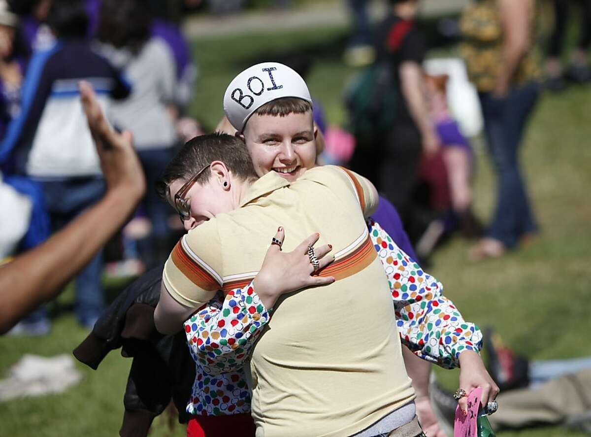 Julz Simpson gives a hug to a friend while celebrating