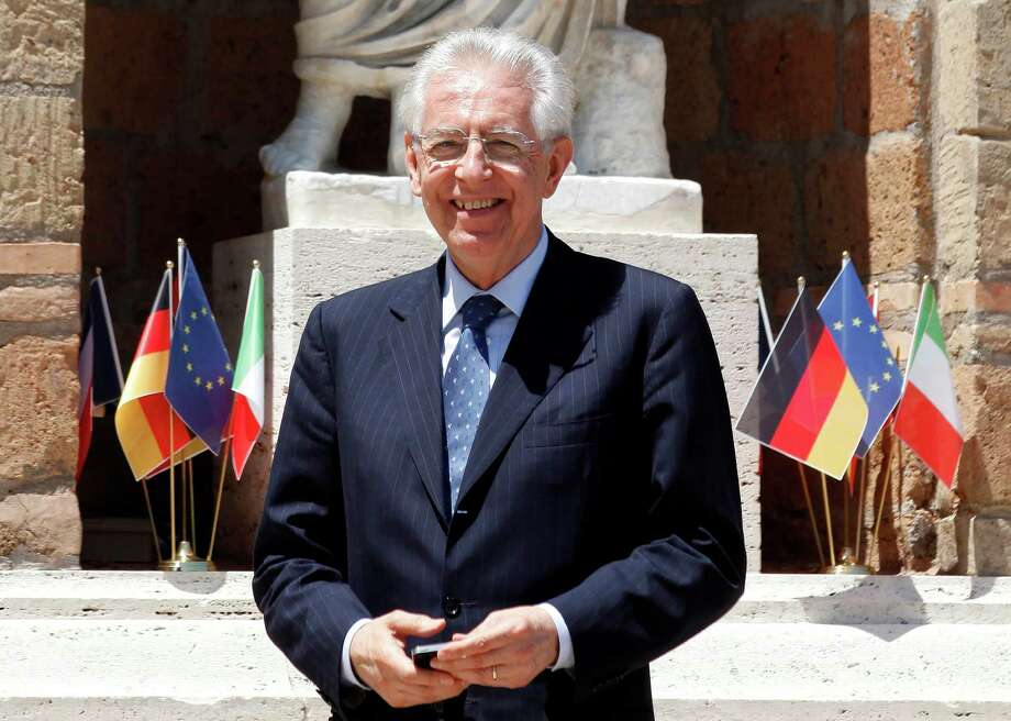 """Mario Monti, Italy's prime minister, reacts before welcoming Francois Hollande, France's France's president, Angela Merkel, Germany's chancellor, and Mariano Rajoy, Spain's prime minister, to Villa Madama for their meeting, in Rome, Italy, on Friday, June 22, 2012. Euro-area leaders need to come up with a blueprint for a tighter fiscal and financial union at a summit next week or there will """"be progressively greater speculative attacks"""" on the currency bloc's """"weaker"""" nations, Monti told newspapers. Photographer: Alessia Pierdomenico/Bloomberg *** Local Caption *** Mario Monti Photo: Alessia Pierdomenico / Copyright 2012 Bloomberg Finance LP"""