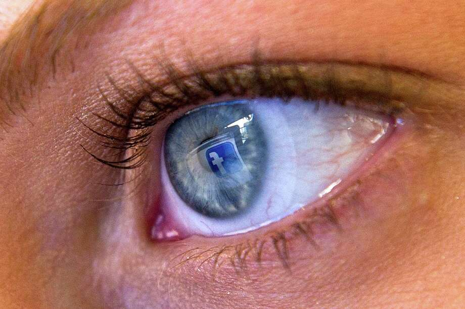 The Facebook logo is reflected in the eye of a user in this arranged photo. Facebook has acquired the facial recognition service Face.com. Photo: David Paul Morris / © 2012 Bloomberg Finance LP