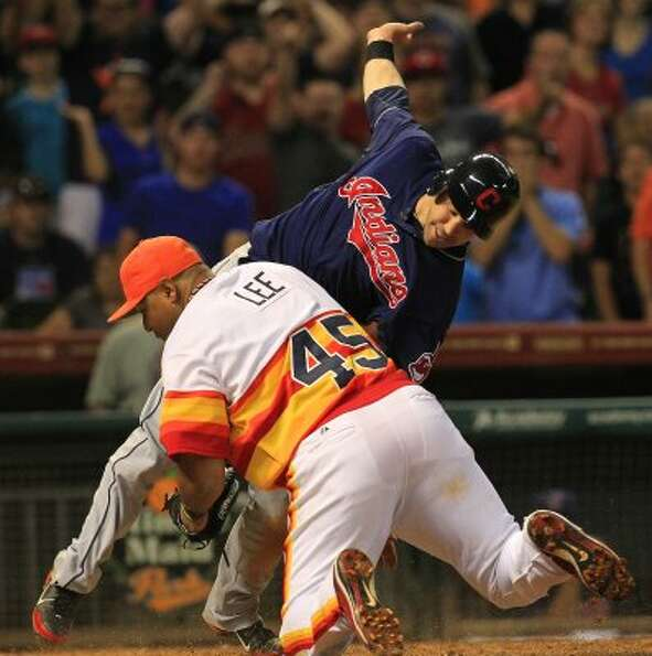 June 22: Indians 2, Astros 0   Carlos Lee collides with Jason Kipnis during
