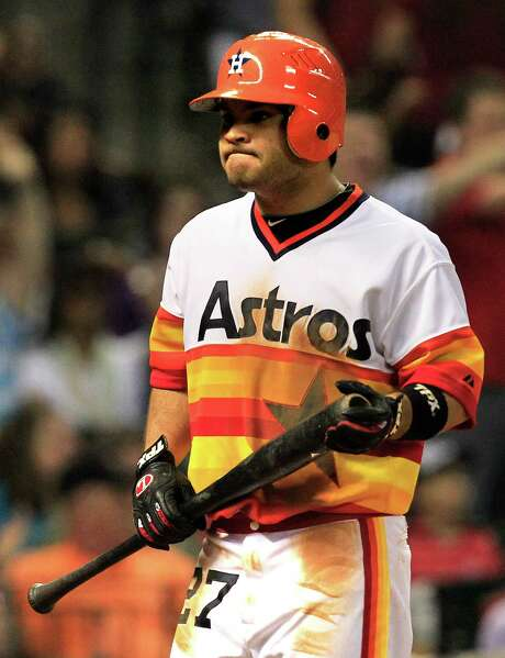 Jose Altuve, in a throwback uniform that salutes the Astros' groovy beginnings. Photo: Cody Duty / © 2011 Houston Chronicle
