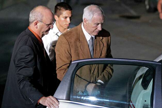 Former Penn State University assistant football coach Jerry Sandusky, right, is escorted by Centre County Sheriff Denny Nau, left, as he is taken into custody at the Centre County Courthouse after being found guilty of multiple charges of child sexual abuse in Bellefonte, Pa., Friday, June 22, 2012. Sandusky was convicted of sexually assaulting 10 boys over 15 years on Friday, accusations that had sent shock waves through the college campus known as Happy Valley and led to the firing of Penn State's beloved Hall of Fame coach, Joe Paterno. (AP Photo/Gene J. Puskar) Photo: Gene J. Puskar