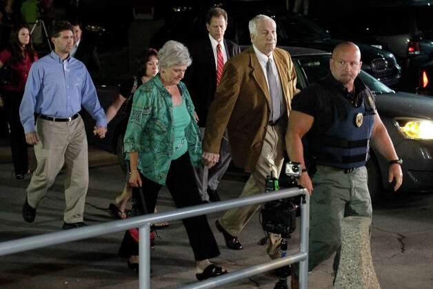Former Penn State University assistant football coach Jerry Sandusky, right center, arrives with his wife Dottie, left center, at the Centre County Courthouse in Bellefonte, Pa., Friday, June 22, 2012. Sandusky is accused of sexual abuse of 10 boys over a 15-year period. (AP Photo/Gene J. Puskar) Photo: Gene J. Puskar