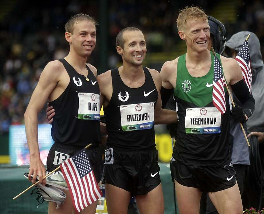 Galen Rupp, Matt Tegenkamp and Dathan Ritzenhein pose after the men's 10,000m finals at the U.S. Olympic Track and Field Trials Friday, June 22, 2012, in Eugene, Ore. Rupp finished first, Tegenkamp second and Ritzenhein third. The three will represent the U.S. in the London Olympics. (AP Photo/Marcio Jose Sanchez) Photo: Marcio Jose Sanchez, Associated Press