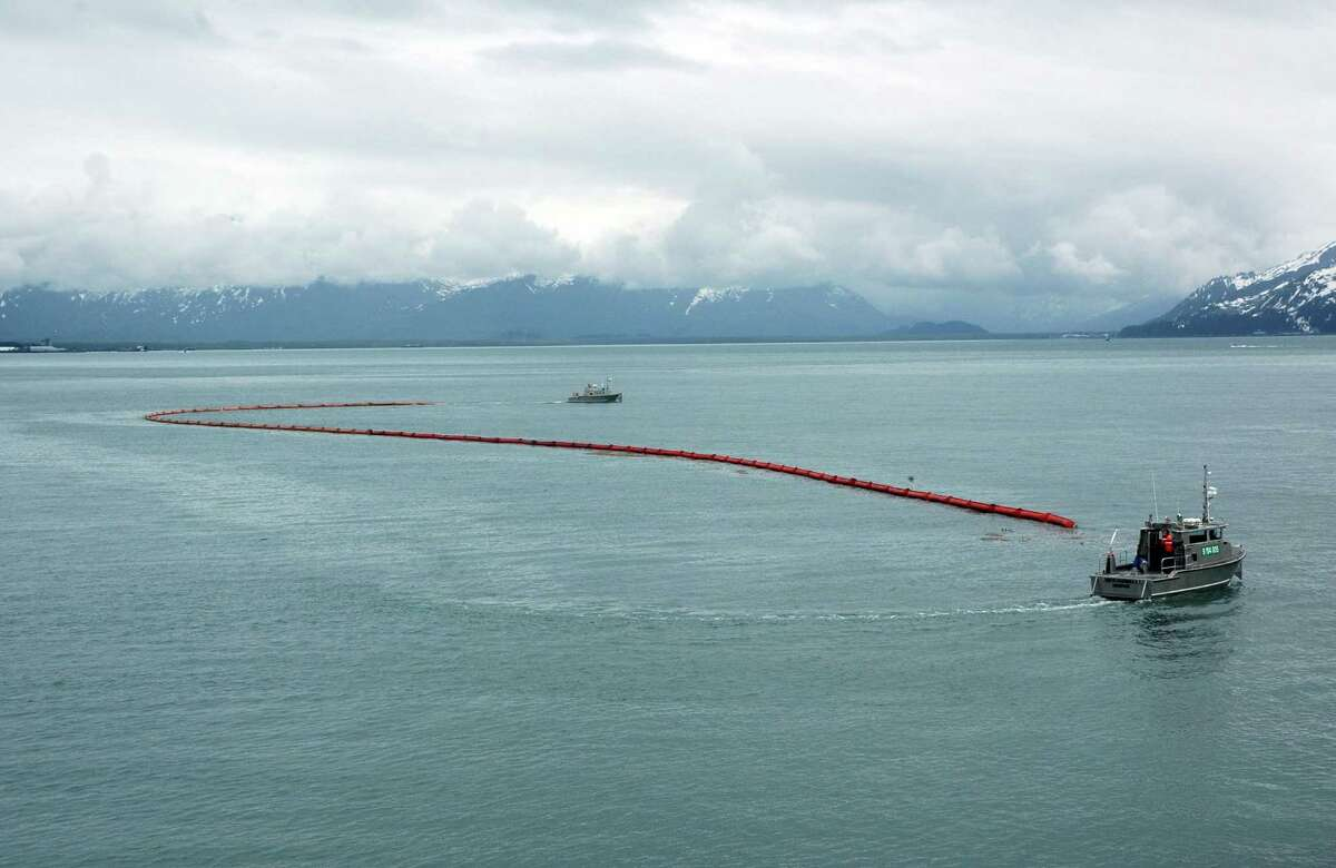 An inflatable boom stretches between two vessels near Valdez during a Shell training exercise for responding to an oil spill. The company is preparing for drilling in Arctic waters north of Alaska. Shell has a flotilla of oil recovery ships.
