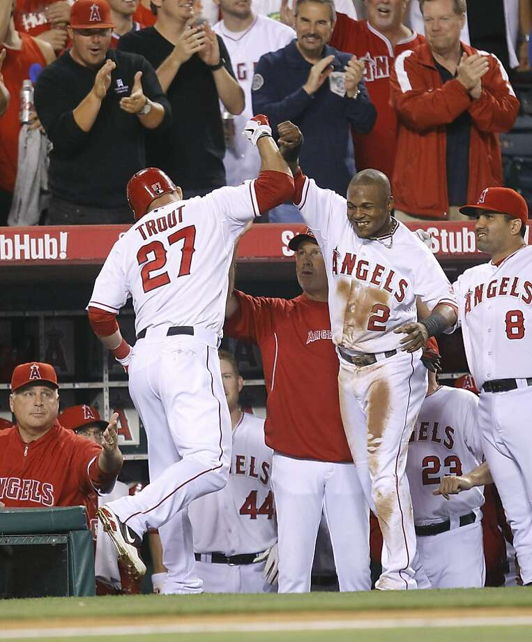 Los Angeles Angels' Mike Trout, left, and Erick Aybar celebrate Trout's home run against the Los Angeles Dodgers in the fourth inning of a baseball game in Anaheim, Calif., Friday, June 22, 2012. (AP Photo/Jae C. Hong) Photo: Jae C. Hong, Associated Press