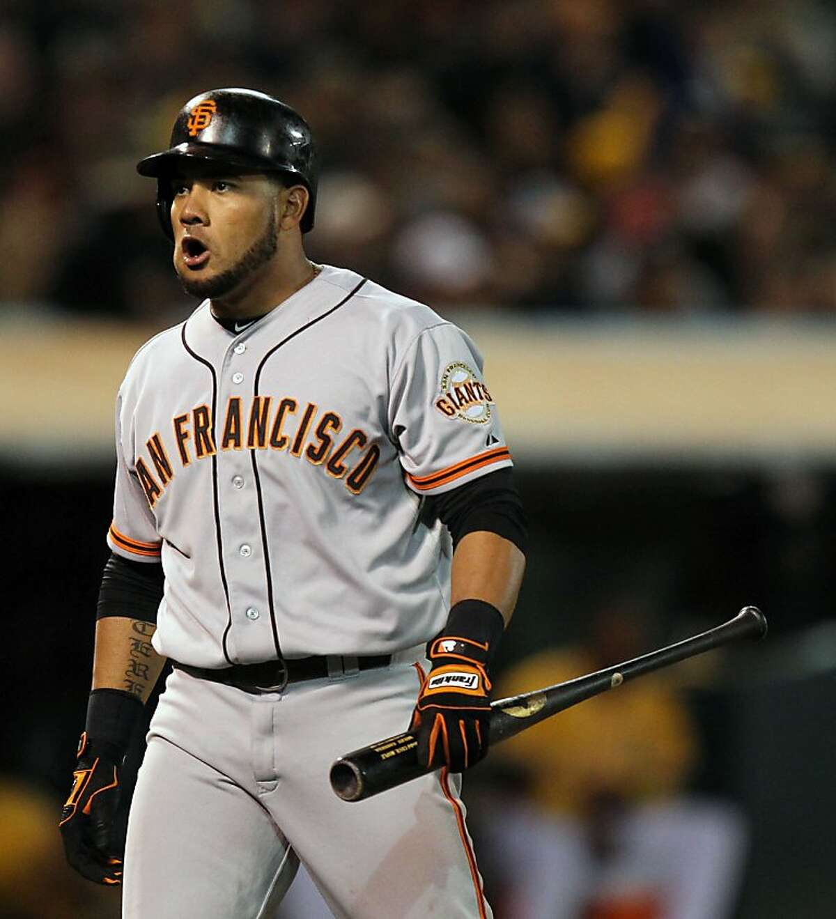 San Francisco Giants Melky Cabrera turns to the Giants dugout and voices his displeasure after striking out in the 8th inning against the Oakland Athletics during their MLB Baseball Game on Friday June 22, 2012 at the Oakland Coliseum, in Oakland California.