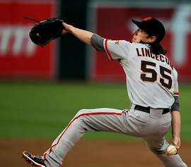 Tim Lincecum of the San Francisco Giants throws from the mound against the Oakland Athletics during their MLB Baseball Game on Friday June 22, 2012 at the Oakland Coliseum, in Oakland California.