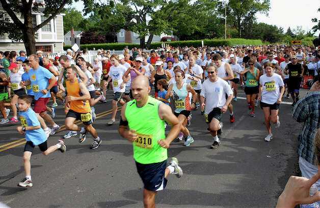 A field of more than 1,400 runners surges from the Jennings Beach starting line for Saturday morning's 5K Run of the annual Stratton Faxon Fairfield Road Races. Photo: Mike Lauterborn / Fairfield Citizen contributed