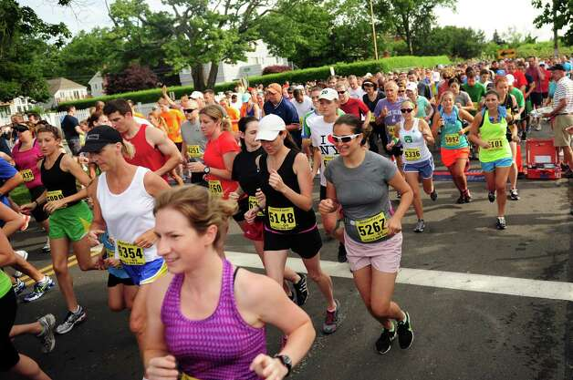 Racers take off at the start of the 32nd Stratton Faxon 5K Saturday, June 23, 2012 at Jennings Beach in Fairfield, Conn. Photo: Autumn Driscoll / Connecticut Post