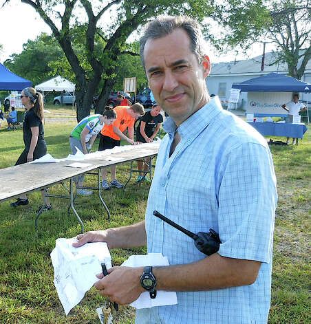 Fairfield 5K Run coordinator John Bysiewicz, on the job at Jennings Beach on Saturday morning. Photo: Mike Lauterborn / Fairfield Citizen contributed