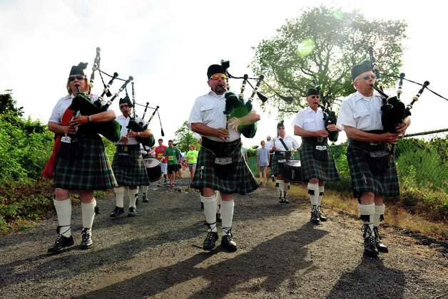 The Fairfield Gaelic Pipe Band leads racers to the starting line at the 32nd Stratton Faxon 5K Saturday, June 23, 2012 at Jennings Beach in Fairfield, Conn. Photo: Autumn Driscoll / Connecticut Post