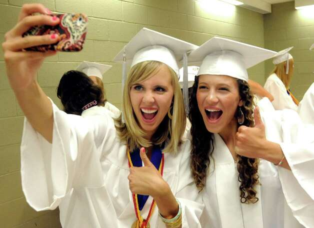 Allie Thoms, left, and Rachel Steiner, take a photo of themselves before the New Fairfield High School graduation at Western Connecticut State University's O'Neill Center in Danbury Saturday, June 23, 2012. Photo: Michael Duffy / The News-Times