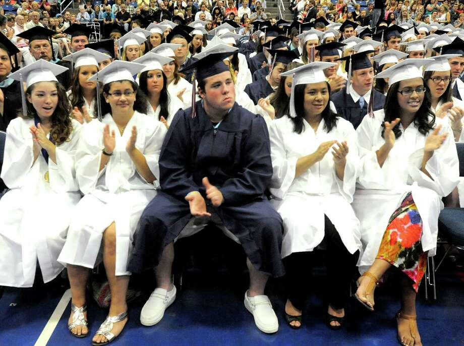 Seniors applaud during the New Fairfield High School graduation at Western Connecticut State University's O'Neill Center in Danbury Saturday, June 23, 2012. Photo: Michael Duffy / The News-Times