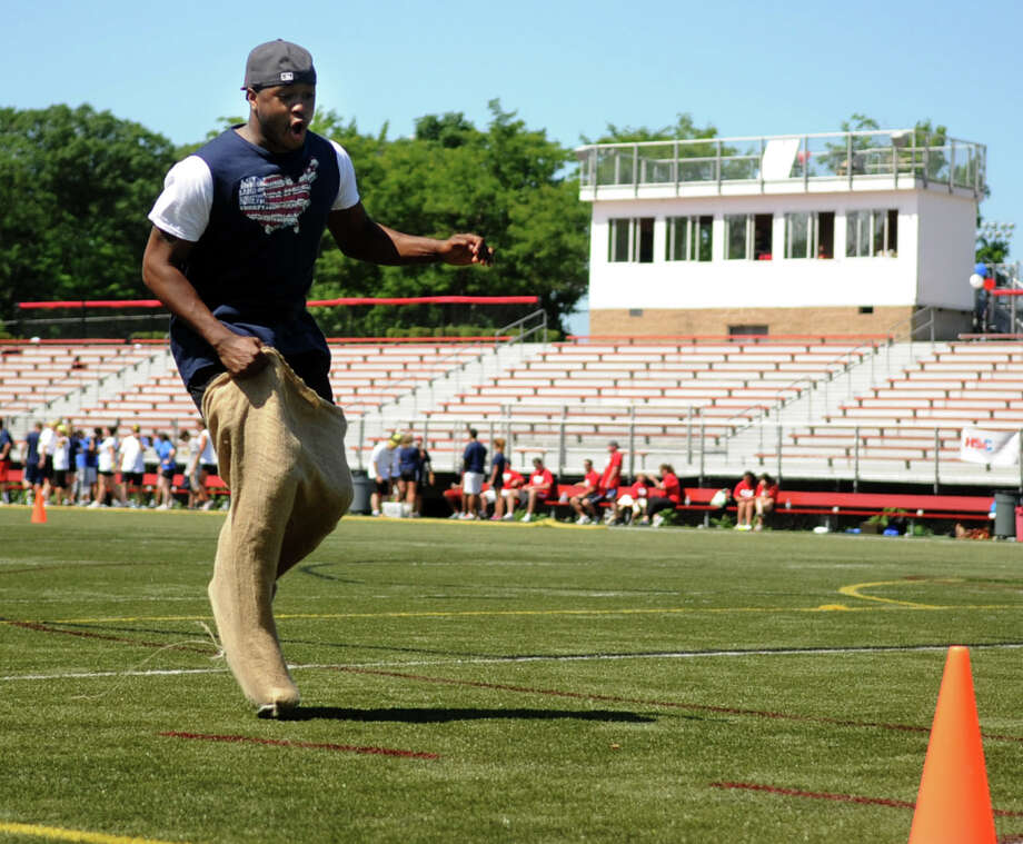 Judson Brown competes in the sack race during the 21st annual Pro Sports Challenge at New Canaan High School on Saturday, June 23, 2012. Photo: Lindsay Niegelberg / Stamford Advocate