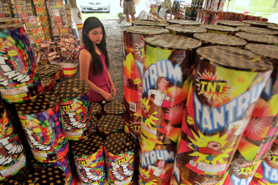 Hazen Dixon, 11, of Danbury, shops with her father at the TNT Fireworks tent on Mill Plain Road in Danbury on Friday, June 22, 2012. Photo: Jason Rearick / The News-Times