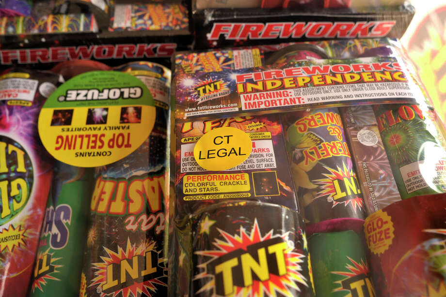 "A ""CT Legal"" sticker, center, at the TNT Fireworks tent on Mill Plain Road in Danbury, lets customers know they are purchasing something that won't get them in trouble with the law. Photographed on Friday, June 22, 2012. Photo: Jason Rearick / The News-Times"