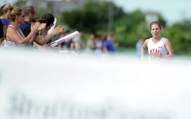 Sharon Lemberger, of Stamford, races in the 32nd Stratton Faxon 5K Saturday, June 23, 2012 at Jennings Beach in Fairfield, Conn.  Lemberger was the first female finisher. Photo: Autumn Driscoll / Connecticut Post