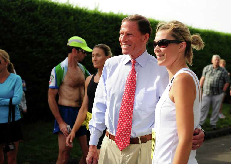 Jennifer DeLawder, of Trumbull, poses for a photograph with Sen. Richard Blumenthal before the 32nd